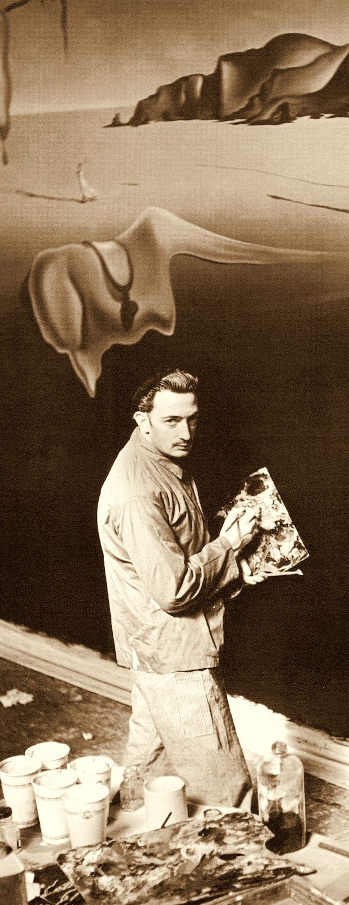 "SALVADOR DALI painting a wall facade of limp watches for his 'DREAM OF VENUS"" funhouse pavilion for adults only. At The 1939 World's Fair. from the book Salvador Dali's Dream of Venus: The Surrealist Funhouse by Ingrid Schaffner with Photos by ERIC SCHAAL. 2002 (please follow minkshmink on pinterest)"