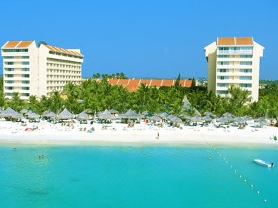 Com uma localização excepcional na impressionante praia de Palm Beach em Aruba, o hotel Occidental Grand Aruba é o lugar ideal para suas próximas férias. Este exclusivo hotel All Inclusive oferece tudo o que você precisa para umas férias de sonho, em um único lugar. Se gostar de atividades aquáticas, de praia, de relaxar e descansar, este é o lugar ideal para você. Descubra este paraíso e aproveite umas férias inesquecíveis entre exóticas palmeiras, areia branca e o mar do Caribe.