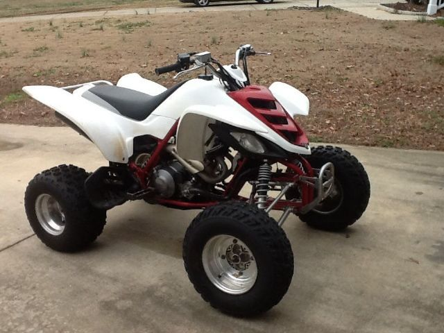 2005 yamaha raptor 660r 4 wheeler red white 100 miles for Four wheelers yamaha for sale