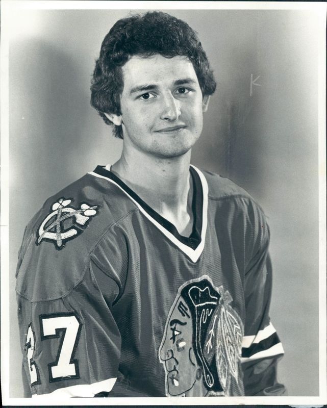 Darryl John Sutter (born August 19, 1958) played hockey with the Chicago Blackhawks of the NHL.  Coached the Blackhawks, San Jose Sharks, Calgary Flames (as well as serving as their General Manager) and led the Los Angeles Kings to Stanley Cup victory in the 2011/12 season.    Picture from:  http://icehockey.wikia.com/wiki/Darryl_Sutter