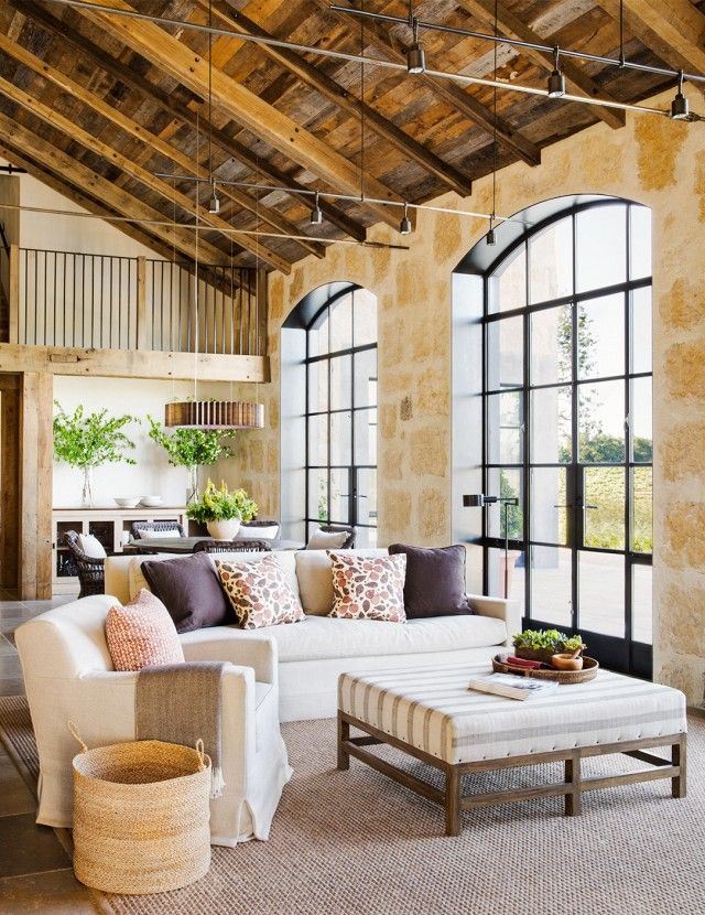 """Balancing the modern take on a French farmhouse with the inherently rustic and primitive nature of such a space wasn't a problem for Davin. """"The modern elements come from keeping everything..."""