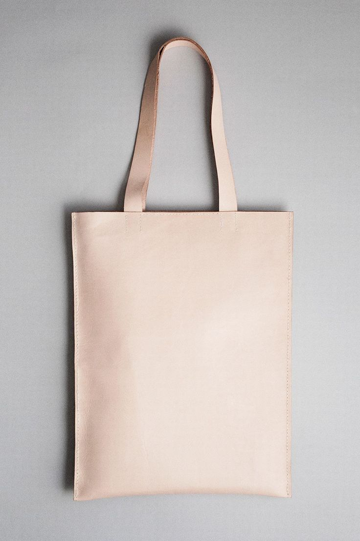 Handmade and hand sewn leather tote bag with shoulder straps and small inner pocket. All edges are hand dyed, - waxed and polished. Fits an 15'' computer.  Handcrafted Leather Goods. Mia Behrens. Copenhagen, Denmark.