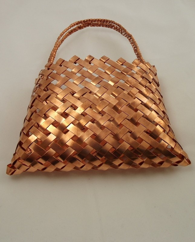 Copper Kete. Maori traditionally used native flax to weave kete [basket]. This modern interpretation is in copper.