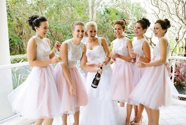 Bridesmaids in matching pink skirts. The Wedding Scoop Spotlight: 8 Bridesmaid Dress Trends We Love #bridesmaid #bridesmaids