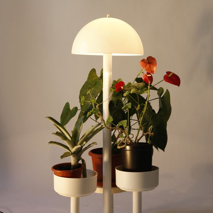 Multifunctional white floor lamp produced in Holland. Besides setting up the atmosphere, it doubles as a three-armed flower planter.