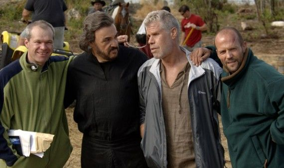 Director, Uwe Boll, and actors, John Rhys-Davis, Ron Perlman and Jason Statham, relax between scenes on the set of the movie, IN THE NAME OF THE KING: A DUNGEON SIEGE TALE.