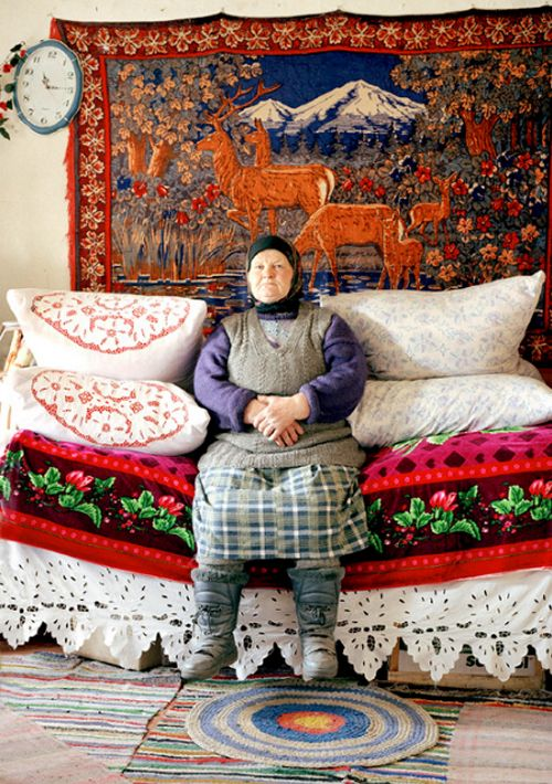 Russian granny. My gran used to have a similar rug on the wall, with the deer, of course