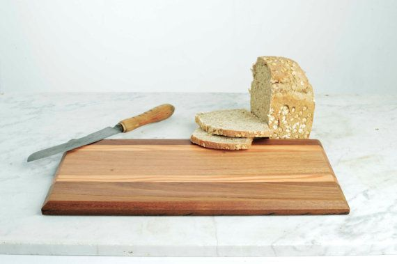 Re-purposed timber cutting board. Etsty Store - One of our lovely bread-boards made from timbers sourced from one of our architectural projects