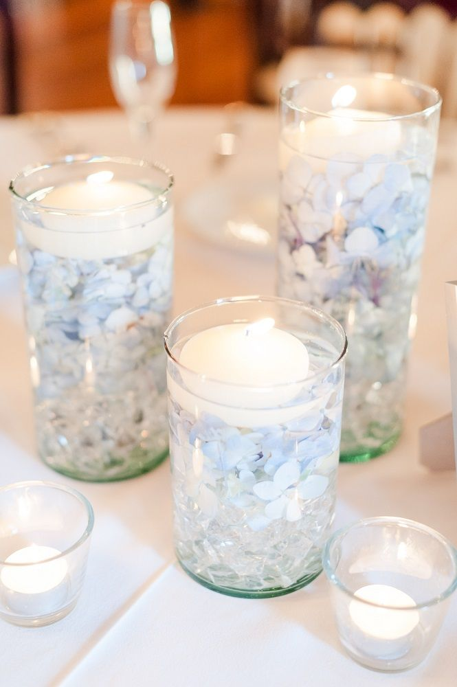 Clear glass cylinder centerpiece with floating candles