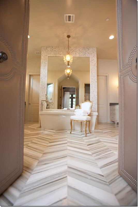 Gorgeous Master Bathroom Design With Marble Herringbone Tile Floor Soaking Tub Gold French Louis Chairs And Crystal Chandelier