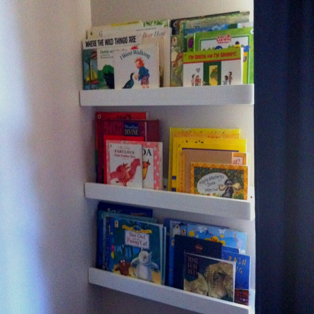Home made book case in a toddler boys room.