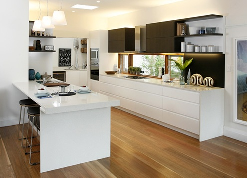 White polyurethane drawers in Dulux Lexicon quarter, with dark overhead cabinets in Laminex Espresso Ligna, timber floor kitchen