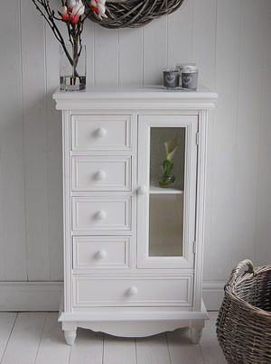 White Storage cabinet with drawers and glass door. 5 drawers - master bedroom?