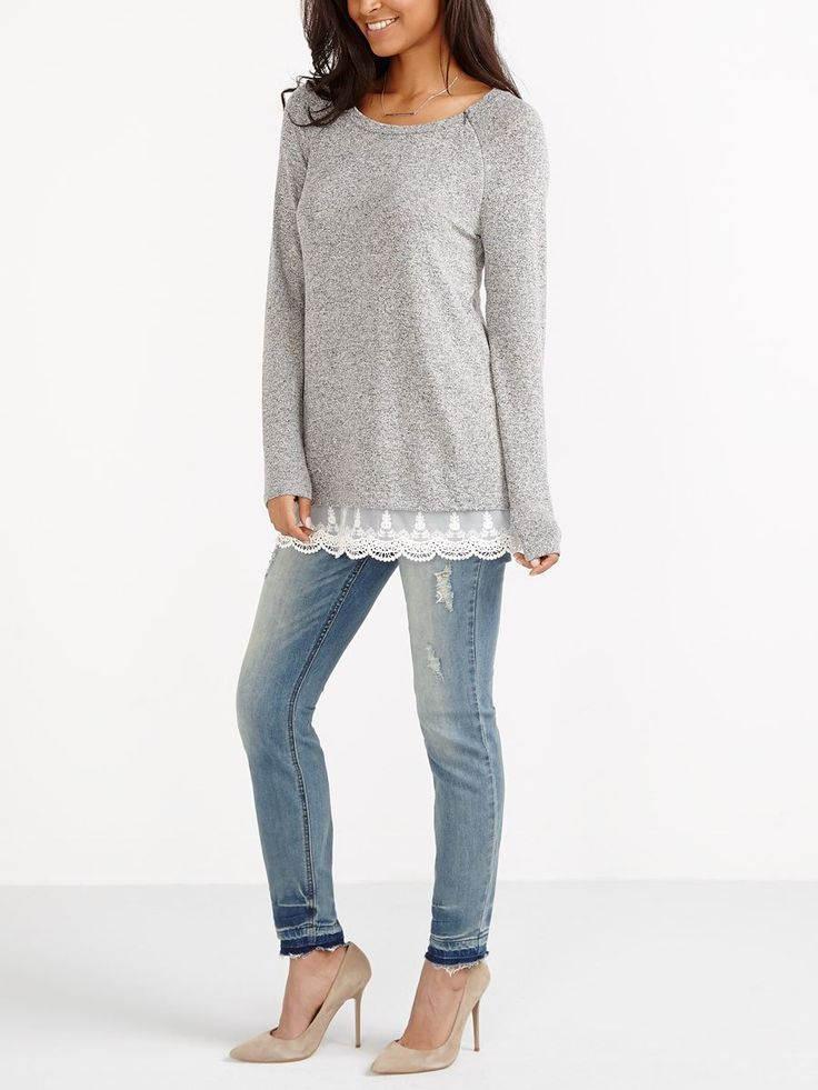 """New moms, meet your new fave top! This nursing top is made with a super soft knit fabric guaranteed to keep you comfy. Side zippers allow for quick access to breastfeed anywhere. You'll love its pretty lace hem for a feminine touch. A rounded neck and long sleeves complete the look.<br /><br />- Length: 28 3/4""""<br />- Coil zippers composed of a plastic spiral for a soft touch<br />- Can be worn during pregnancy and nursing"""