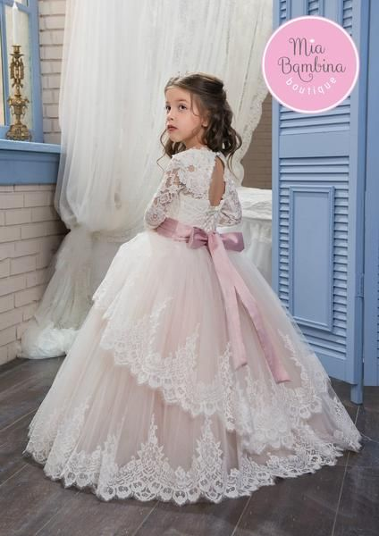 eef080f257b The Arlington ball gown style flower girl dress has a princess appearance.  The lace bodice features long floral lace sleeves