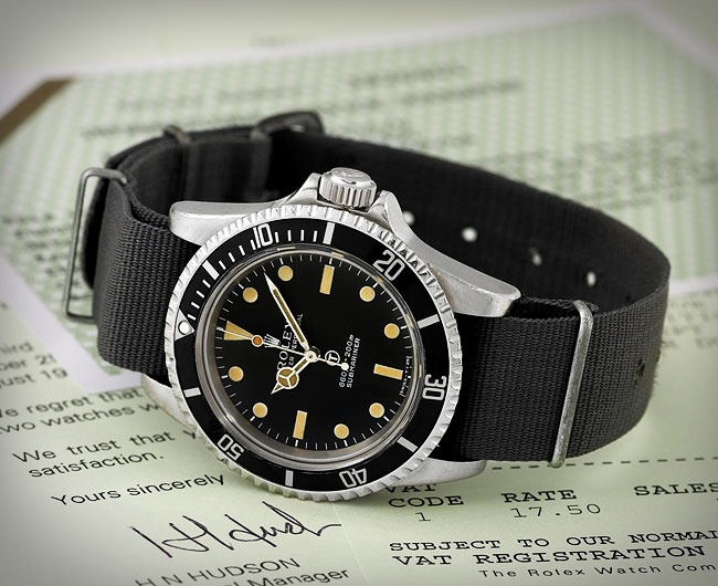"Vintage 1972 British Military Rolex Submariner. Ref. 5513. ""Manufactured in 1972 for issue to the Royal British Navy, this rare automatic water-resistant (200 meters) Oyster Perpetual Submariner Rolex is certified by Rolex UK confirming delivery to the British Ministry of Defense in 1975."""