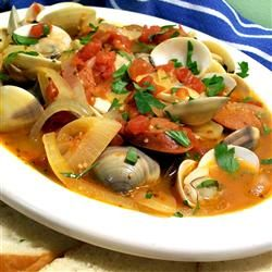 Portuguese Steamed Clams ~ clams in shell (scrubbed), chorizo (sliced into chunks), onion (cut into thin wedges), minced garlic, can diced tomatoes, white wine, olive oil, some hot pepper for heat