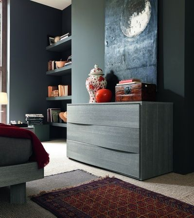 Unusual curved drawer fronts to our Cloud Chest of Drawers shown here in grey wood finish.