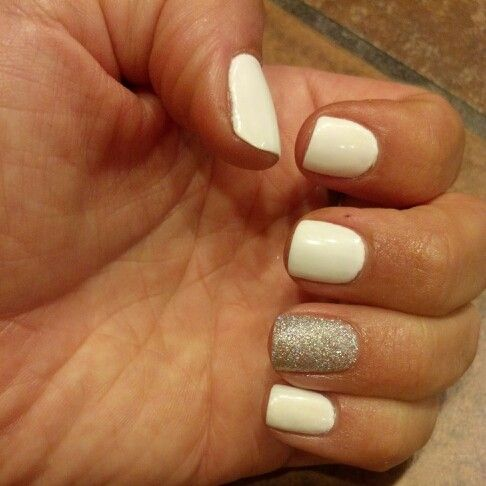 White shellac nails and a silver glitter accent