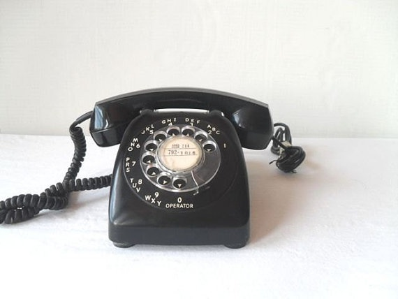 Our phones used to look like this.....and had BELL ringer.  OV-43047 was my first phone number.