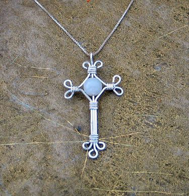 This is also a lovely wrapped-wire cross ~ with a bead.