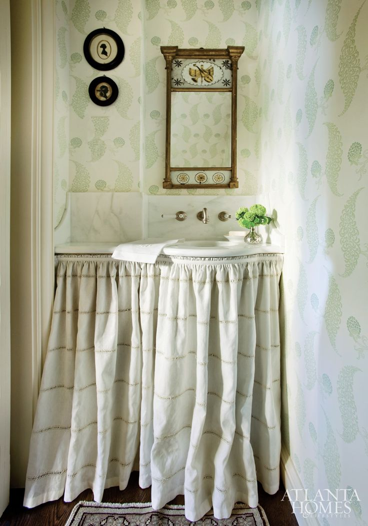Tucked under a stairwell, the powder room is prettied up with linen skirting, graphic wallpaper and a Federal mirror.: Rooms Inspiration, Bathroom Vanities, Graphics Wallpapers, Atlanta Home, Small Spaces, Sinks Skirts, Powder Rooms, Design Blog, American Beautiful
