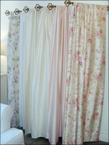 shabby chic curtains. thinking of using some of these for the backyard door.