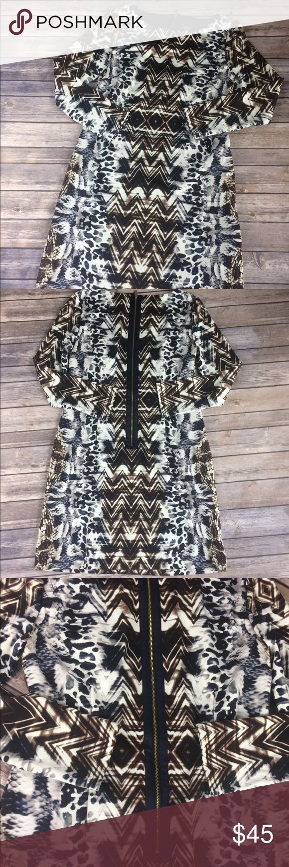 """Vince Camuto Tribal Animal Print Long Sleeve Dress Vince Camuto Tribal Animal Print Long Sleeve Dress With Brown, Blue, Gray. Very Chic!  Gently Used Condition. No Flaws or stains. See photos.  Underarm-Underarm: 17' Length:34' Waist:16"""" Inseam: Hips:19"""" All Measurements are Approximate.  Materials:95% Vince Camuto Dresses"""