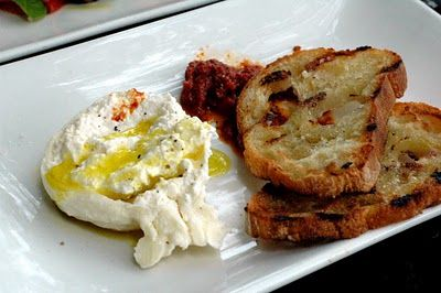 Warmed Buratta Cheese, drizzled with Truffle oil and grilled rustic bread that's been soaked in garlic oil..