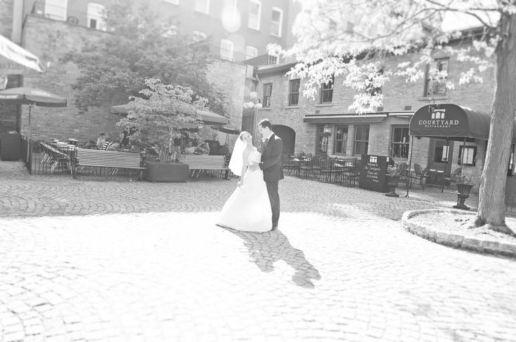 A couple sharing a beautiful moment in the outside courtyard of Courtyard Restaurant in Ottawa, Ontario. Photo credit: AR Photography.  #ottawaweddings www.aaronrodericks.com
