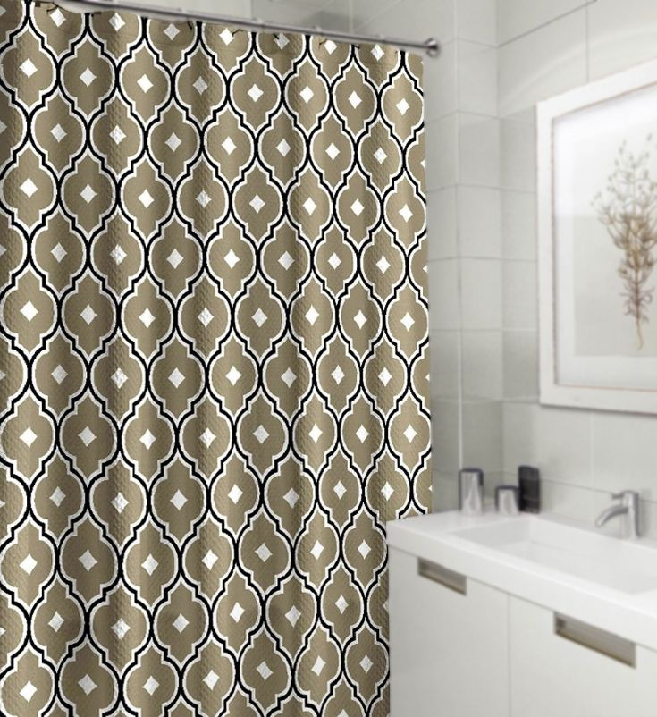 Inspired by geometric fretwork design, the Renard shower curtain will add contemporary style to any bath. The taupe quatrefoil trellis pattern is lined with black for a bold touch. This fabric shower curtain is made of water resistant polyester and is machine washable for easy care. Simply hang the curtain from the reinforced stitched grommets for an instant bathroom style update. The Renard shower curtain measures 70 x 72 inches and will fit standard sized tubs.
