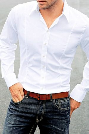 Custom fitted white shirt paired with a medium dark jean and a tan leather belt.