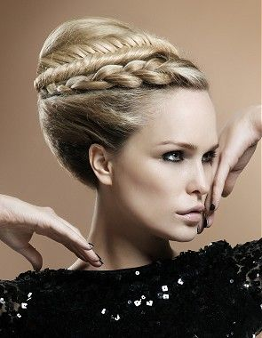 A long blonde straight coloured multi-tonal plaited sculptured updo beehive hairstyle by Harry Boocock