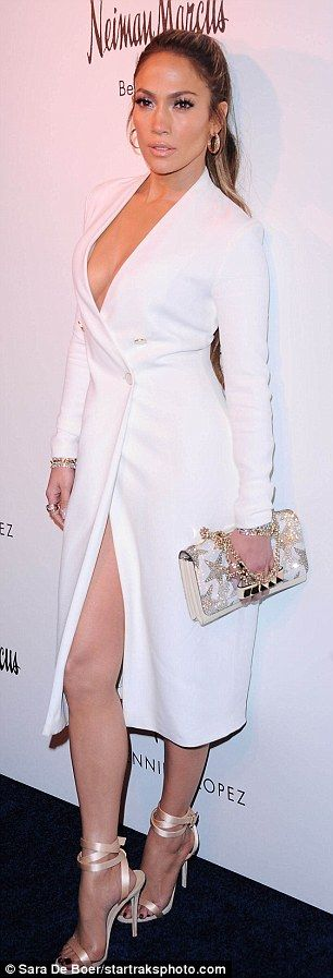 Baring it all: Jennifer Lopez, 47, donned a low-cut blazer dress for the Jennifer Lopez and Giuseppe Zanottis Shoe Capsule Collection launch in Los Angeles on Thursday night