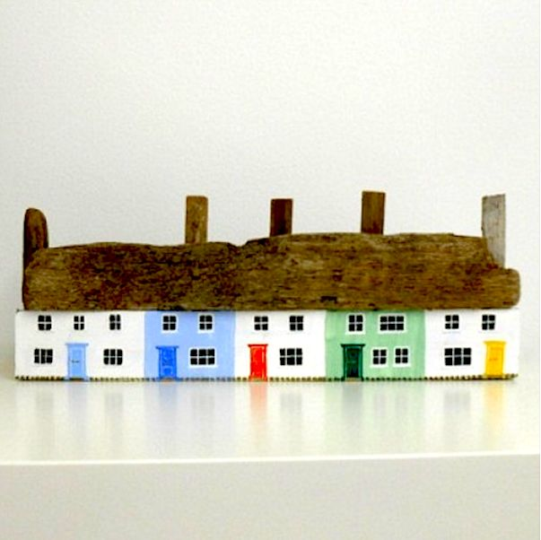 COASTAL November 2013: Driftwood Cottages - an intricately painted row of driftwood cottages, by Hampshire based artist Colin M Baxter. Each cottage features a different coloured front door. Colin is happy to take commissions so you can see your favourite pub, fish and chip shop or village featured. Free UK delivery. Colin can take commissions on similar pieces but there will be a wait of up to 6 weeks. Price: £65.00. From www.shoalseasideliving.com.