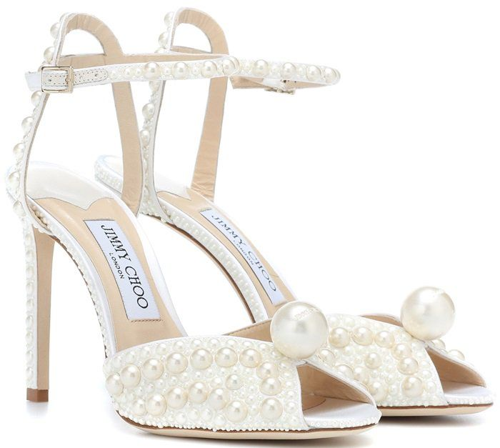58e25d4ba Sacora from Jimmy Choo is a vintage inspired sandal crafted in  sophisticated white satin covered in faux pearls. Boasting an elegant V cut peep  toe and