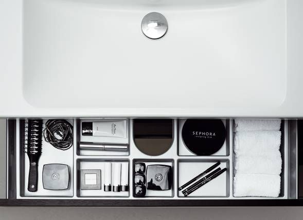 Forma drawers have practical dividers to keep bottles upright and a non-slip mat.