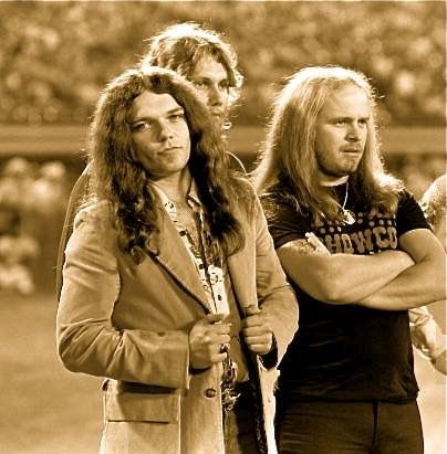 Members of Lynyrd Skynyrd (from left to right) Gary Rossington-guitar, Steve Gaines-guitar and Ronnie Van Zant- vocals attend the season opening pre-game presentation of the Atlanta Braves on April 15, 1977. Please note RVZ's SHOWCO shirt. This iconic shirt currently resides in my personal collection and will be featured in the book SHOWCO: 10,000 Nights On The Road. Please like my FB SHOWCO the Book. Thank you!