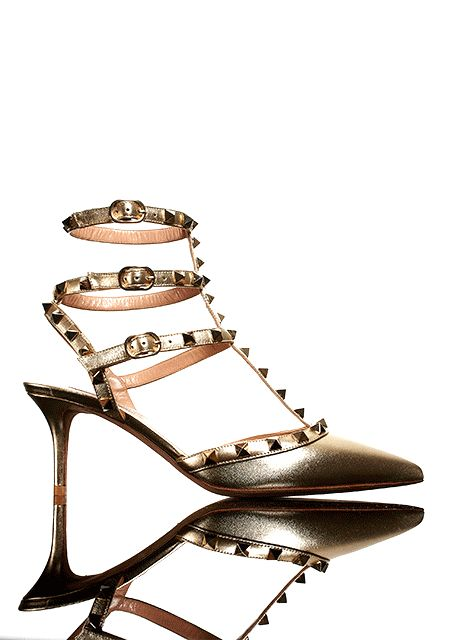 Classics: Valentino Rockstud Metallic Leather Sandal in gold.