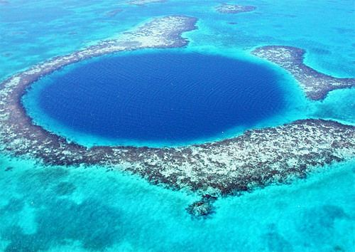 Great Blue Hole, Belize- a large submarine sinkhole off the coast of Belize. It lies near the center of Lighthouse Reef, a small atoll 70 km from the mainland and Belize City. The hole is circular in shape, over 300 m across and 124 m deep.