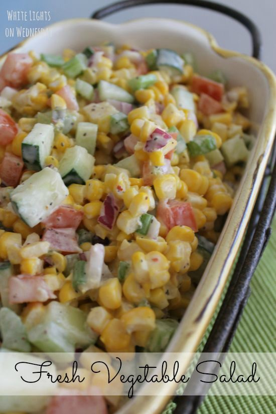 Fresh Vegetable Salad with corn, tomatoes, celery and cucumber