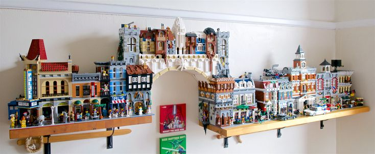 https://flic.kr/p/Kzogjq | The Constantine Lego Bridge | The Constantine Bridge in place spanning the two shelves in my study. It was designed to span the gap (and deal with the change in height) as well as fit into the size and layout of the modular buildings.  Full album can be found here: www.flickr.com/photos/mcmorran/albums/72157669784683114