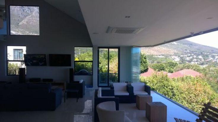 Frameless doors lounge enclosure