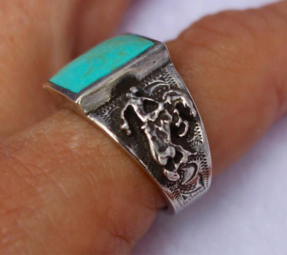 """Roy"" is sterling silver ring with a 10mm X 14mm bezel set Kingman Turquoise. This ring is awesome for men or women, available in sizes 5 through 13. Due to the uniqueness of turquoise, stone color will vary. The Roy ring can be purchased on our Etsy store for $119."