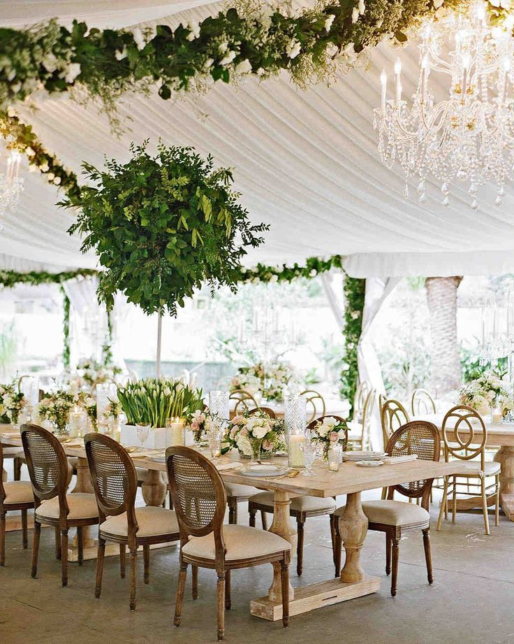 An Epic New Orleans Wedding with Classic Touches | Martha Stewart Weddings - Arrangements of roses, lilacs, hydrangeas, and tulips adorned the dining tables, which were crowned by foliage topiaries.