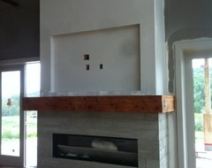Another mantle I'm in love with.  I acctually like the board form tiles too.  www.2stone.ca