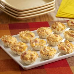 A creamy buffalo chicken dip recipe, made with zesty tomatoes, is baked in mini fillo shells for a tasty appetizer