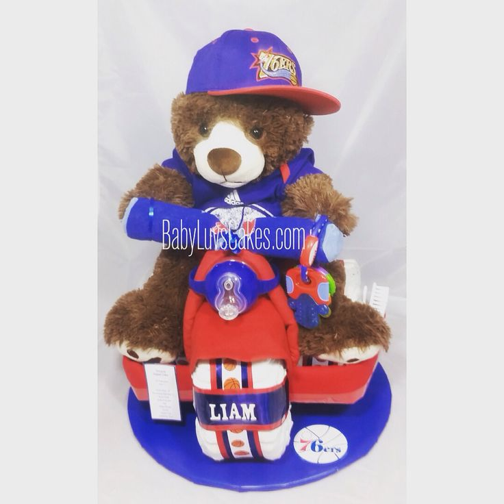 Philadelphia 76ers basketball themed diaper cake. Our tricycle makes the ultimate baby gift for a sports fan. Designed by BabyLuvsCakes.