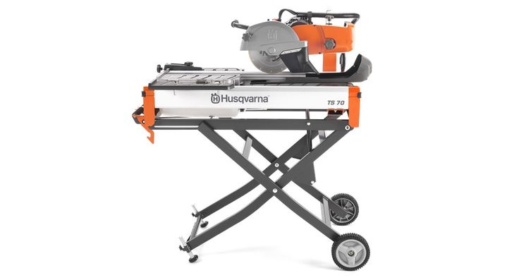 """TS 70 Husqvarna Tile Saw. 28"""" rip cut and cut 20""""x 20"""" tiles diagonal. Cutting depth 2 3/4"""". TS 70 is the perfect choice for fast and effective cutting of materials up to 28 inches in length. The optional adjustable stand enables one person to move the TS 70 around the job site. With the optional stands the tile saw can easily be positioned to various heights or collapsed with one hand."""