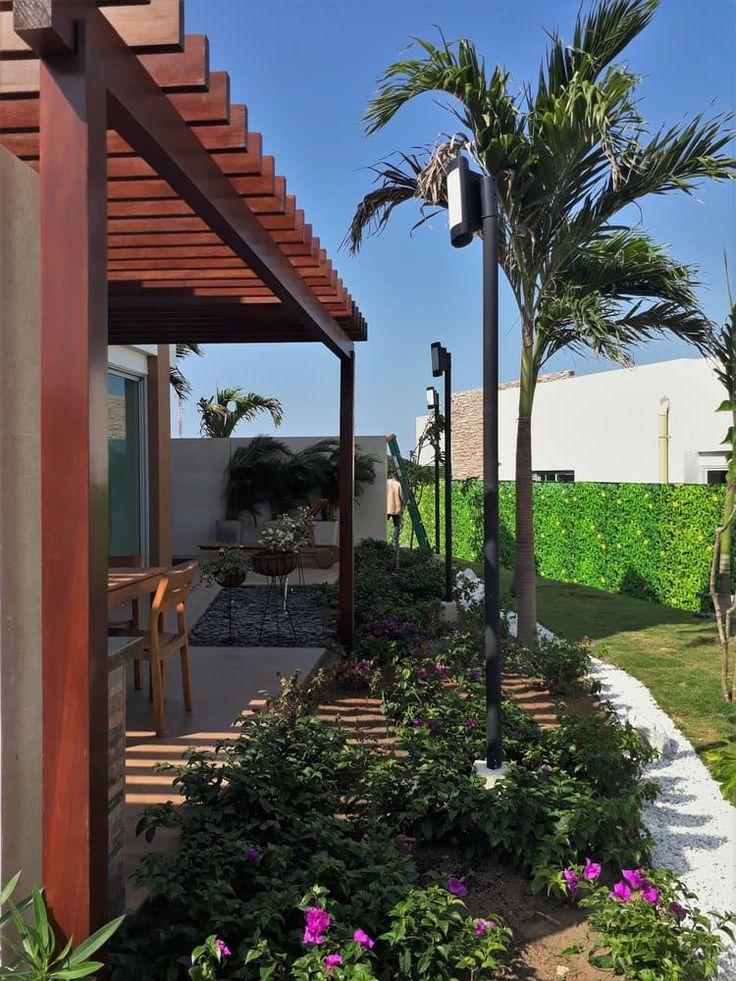 Busca imágenes de diseños de Jardines estilo tropical: Casa modelo Cerdeña - Novaterra Ocean City. Encuentra las mejores fotos para inspirarte y y crear el hogar de tus sueños.